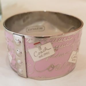Coach, wide silver bangle with whimsical  design